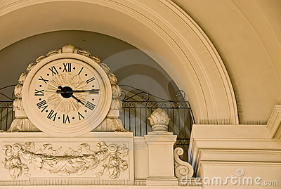 Stone clock under arch