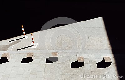 Stone cubes on pavement Stock Photo