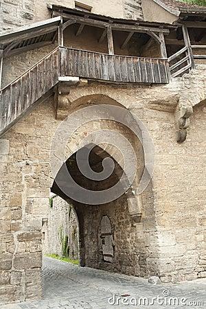 Stone door in historical city wall