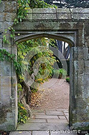 Free Stone Entrance Leading To A Formal Garden. Stock Photos - 46519683