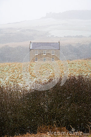 Stone Farmhouse Against Snowy English Landscape