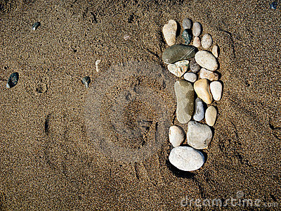 Stone foot  in the sand