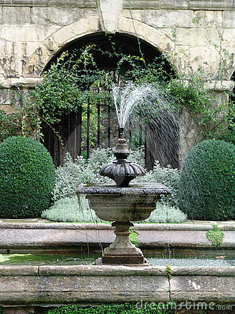 Stone fountain in classical garden