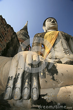 Stone hand of Buddha covered by orange fabric from the temple of Wat Yai Chai Mongkol in Ayutthaya, Thailand.