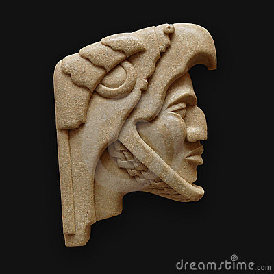 Stone head of warrior carving latin america