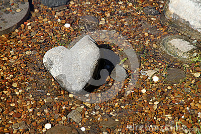 Stone Heart in a stream.  Japanese garden.