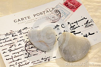 Stone hearts with postcard