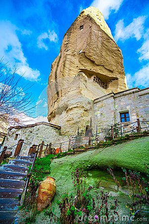 Stone House With Stairs Landscape In Goreme Valley, Cappadocia, Turkey Stock Photo