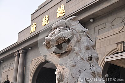 A stone lion statue before office of the president