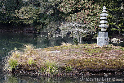 Stone pagoda statuary feature Kinkaku-ji garden