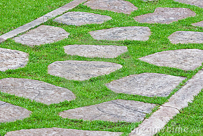 Stone path on green grass