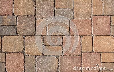 Stone pavement, background of red granite blocks
