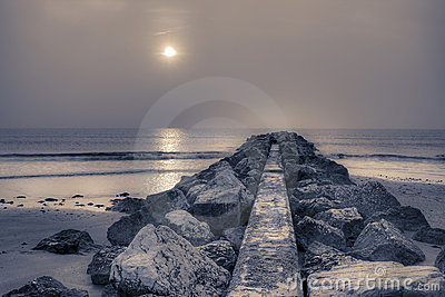 Stone pier at sunrise.