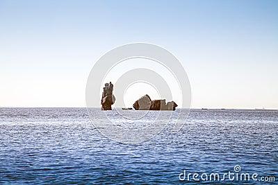 Stone pillar in the sea