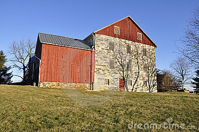 Stone and red wood barn