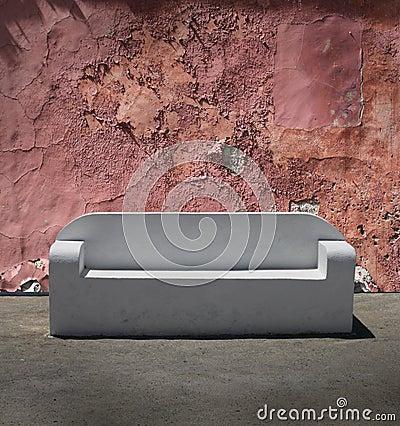 Stone sofa cracked plaster wall