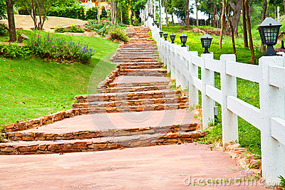 Stone stair with white fence