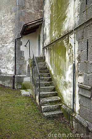 Stone staircase on green wall