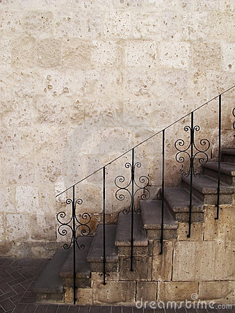 Stone stairs with metal railings, Peru.