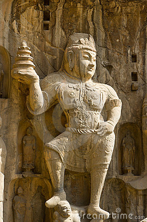 Stone statue of a heavenly king in the Longmen Gro