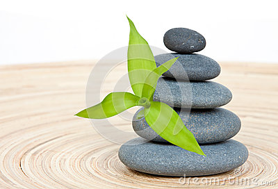 Stone tower with green bamboo leaf