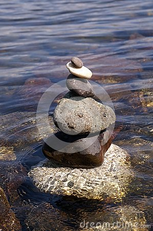 Stone tower on water