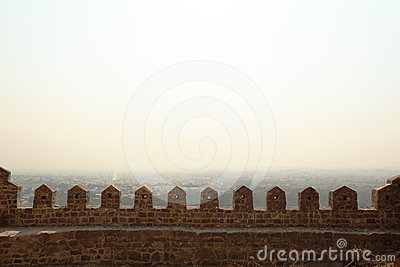 Stone turrets and smokey sky, Golconda Fort