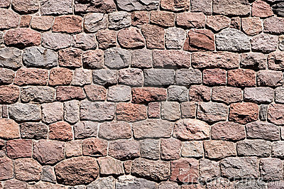 Stone wall background of natural stones
