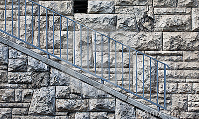 Stone wall with blue railings