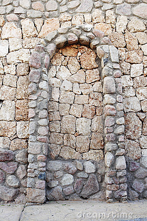 Stone wall with corbel arch