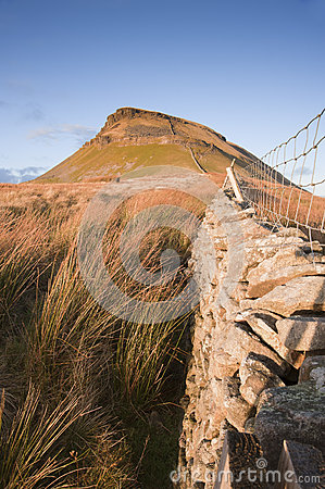 Free Stone Wall Leading Up To Pen-y-Ghent In Yorkshire Dales National Stock Photography - 29778432