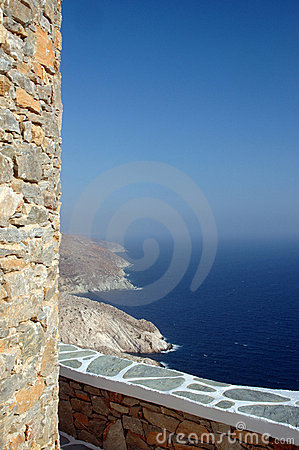 Stone wall by sea rocky coastline greek islands