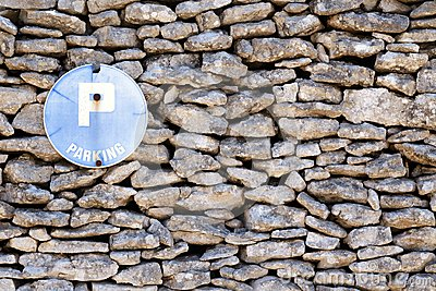 Stone wall and sign