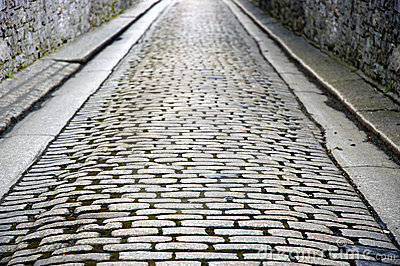 Stone walled cobbled street