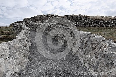 Stone walls and gravel path
