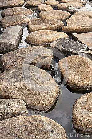 Stone on water