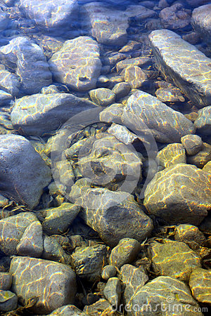 Stone in water