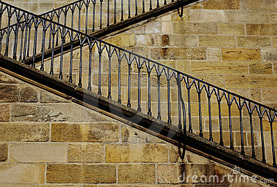 Stone zigzag stairway with iron railing