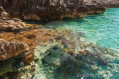 Stones of emerald lagoon in Adriatic Sea