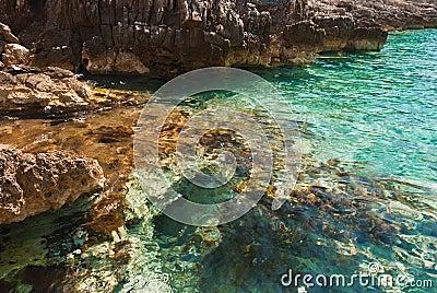 Stones of emerald lagoon in Adriatic Sea