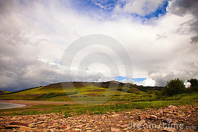 Stones and green hills