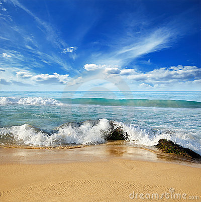 Stones in the waves on ocean coast