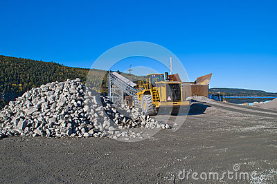 Stones and wheel loader on brekke quarries.