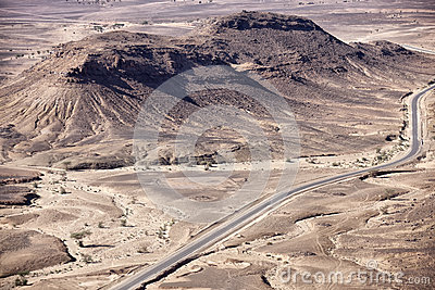 Stony desert landscapes with paved road, Sahara.
