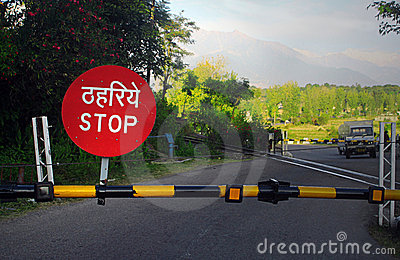 Stop barricade on railroad crossing, India