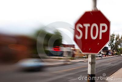 Stop Sign Blurred Traffic