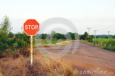 Stop sign in country road