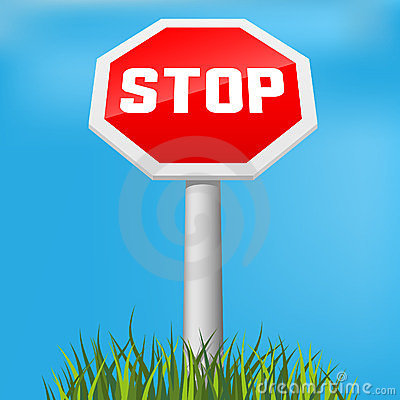 Stop sign in grass