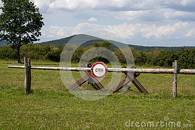 A stop sign posted at Checkpoint Alpha in East Germany in Russian