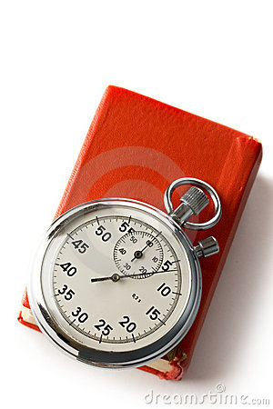 Stopwatch and book Stock Photo